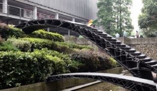 Students work together to create the world's first robotic 3D printed bridges