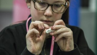 a group of middle school students is creating 3D printed hands